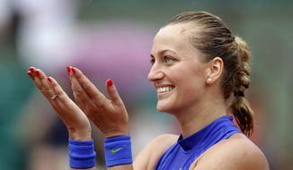Petra Kvitova of the Czech Republic thanks the crowd after defeating Julia Boserup, of the U.S, in their first round match of the French Open tennis tournament at the Roland Garros stadium, Sunday, May 28, 2017 in Paris. (AP Photo/Petr David Josek)