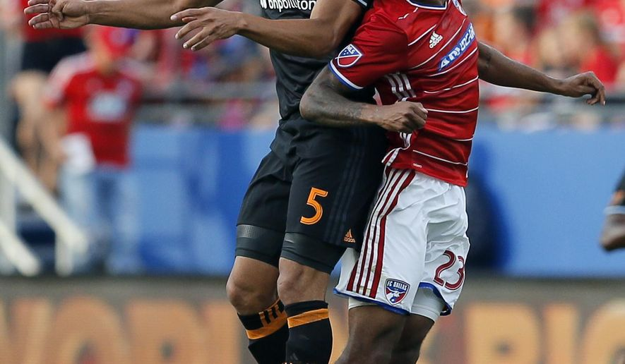 Houston Dynamo midfielder Juan Cabezas (5) and FC Dallas midfielder Kellyn Acosta (23) compete for a header in the first half of an MLS soccer game, Sunday, May 28, 2017, in Frisco, Texas. (AP Photo/Tony Gutierrez)