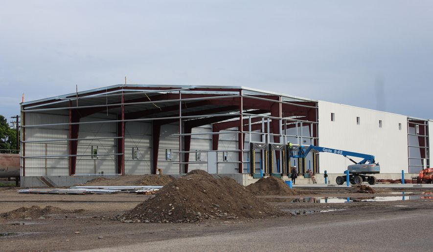 Work continues on the construction of a new facility for product finishing and shipping of onions for the new Baker & Murakami Produce Co. in Ontario, Ore. Set to be complete in July, the new facility resulted from the merger of Baker Packing Company and Murakami Produce Company.   (Larry Meyer/Argus Observer via AP)