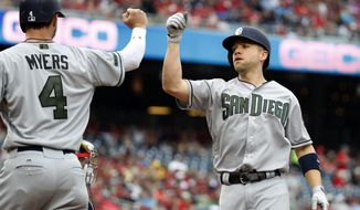 San Diego Padres' Wil Myers, left, celebrates scoring with Ryan Schimpf on Schimpf's two-run home run during the first inning of a baseball game against the Washington Nationals at Nationals Park, Sunday, May 28, 2017, in Washington. (AP Photo/Alex Brandon)