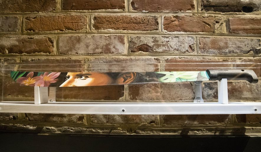 """This Wednesday, May 24, 2017 shows Carlos Lopez Rosa's """"Abriendo Camino"""" a portrait of Nina Gualinga, located inside the Betsy Ross House in Philadelphia. The """"Revolutionary: A Pop-Up Street Art Exhibition"""" on display until July 4, features 13 artists who created works that challenge the status quo. (AP Photo/Matt Rourke)"""