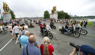 In this file photo, motorcyclists cross the Memorial Bridge during the 30th anniversary of the Rolling Thunder 'Ride for Freedom' demonstration in Washington, Sunday, May 28, 2017. Rolling Thunder seeks to bring full accountability for all U.S. prisoners of war and missing in action (POW/MIA) soldiers. (AP Photo/Cliff Owen)