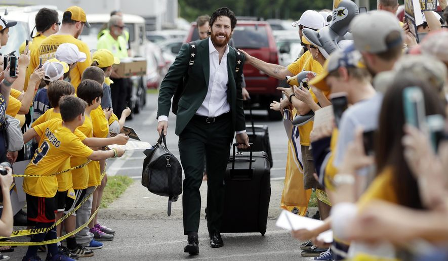 Nashville Predators right wing James Neal is greeted by fans as players arrive at the airport Saturday, May 27, 2017, in Nashville, Tenn., for their flight to Pittsburgh for the NHL hockey Stanley Cup Finals. The Predators face the Pittsburgh Penguins in Game 1 on Monday, May 29. (AP Photo/Mark Humphrey)