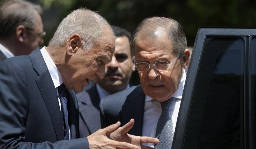 Russian Foreign Minister Sergey Lavrov, right, listens to Arab League Secretary-General, Ahmed Aboul Gheit, as he departs the Arab League headquarters after meetings, in Cairo, Egypt, Monday, May 29, 2017. (AP Photo/Amr Nabil)