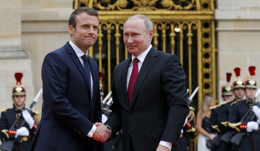 Russian President Vladimir Putin, right, and French President Emmanuel Macron pose for a photo at the Palace of Versailles, near Paris, France, Monday, May 29, 2017. Monday's meeting comes in the wake of the Group of Seven's summit over the weekend where relations with Russia were part of the agenda, making Macron the first Western leader to speak to Putin after the talks. (AP Photo/Alexander Zemlianichenko, pool)