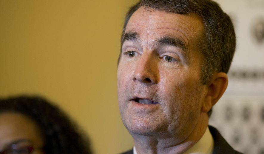 FILE - In this Wednesday April 5, 2017, file photo, Virginia Lt. Gov. Ralph Northam, center, speaks to the media during a news conference on Medicaid expansion prior to the Senate session at the Capitol in Richmond, Va. Northam and Tom Perriello are promising fierce resistance to Trump's immigration positions and are embracing policies such as allowing undocumented immigrants to obtain driver's licenses. (AP Photo/Steve Helber, File)