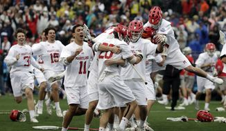 Maryland players celebrate after defeating Ohio State in the NCAA college Division 1 lacrosse championship final, Monday, May 29, 2017, in Foxborough, Mass. Maryland won 9-6 to win the championship. (AP Photo/Elise Amendola) **FILE**