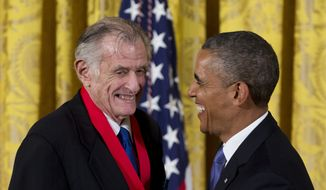 FILE - In this July 10, 2013, file photo, President Barack Obama laughs with Frank Deford as he awards him the 2012 National Humanities Medal during a ceremony in the East Room of White House in Washington. Award-winning sports writer and commentator Frank Deford has died. He was 78.  Deford passed away Sunday, May 28, 2017, in Key West, Florida, his family confirmed.  (AP Photo/Carolyn Kaster, File)
