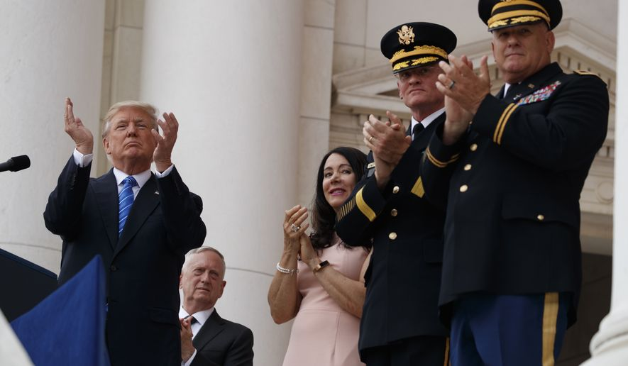 President Donald Trump applauds as he pauses during his speech at a Memorial Day ceremony at Arlington National Cemetery, Monday, May 29, 2017, in Arlington, Va. (AP Photo/Evan Vucci)