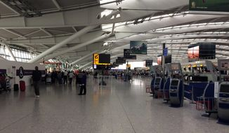 In this file photo, a view of Terminal 5 check in desks, at London's Heathrow airport after flights were canceled due to the airport suffering an IT systems failure, Saturday, May 27, 2017.   (AP Photo /Jo Kearney) **FILE**