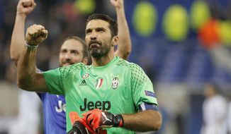 FILE - In this Oct. 18, 2016 file photo Juventus goalkeeper Gianluigi Buffon clenches his fist after the Champions League Group H soccer match against Lyon, in Lyon, central France. Juventus will face Real Madrid in the Champions League final in Cardiff, Wales, on Saturday, June 3, 2017. (AP Photo/Laurent Cipriani, files)