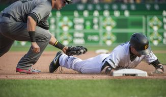 Pittsburgh Pirates' Chris Stewart beats the tag by Arizona Diamondbacks' Jake Lamb (22) after a two-run triple during the seventh inning of a baseball game in Pittsburgh, Monday, May 29, 2017. (AP Photo/Phil Long)