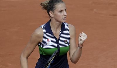 Czech Republic's Karolina Pliskova celebrates as she defeats China's Saisai Zheng during their first round match of the French Open tennis tournament at the Roland Garros stadium, Monday, May 29, 2017 in Paris. Pliskova won 7-5, 6-2. (AP Photo/Petr David Josek)