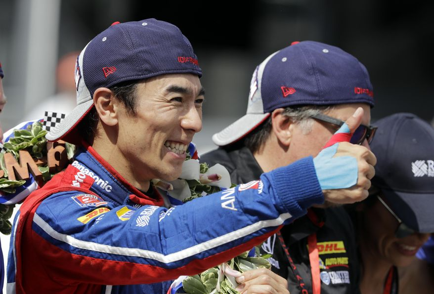 Takuma Sato, of Japan, celebrates on the Yard of Bricks on the start/finish line after winning the Indianapolis 500 auto race at Indianapolis Motor Speedway, Sunday, May 28, 2017 in Indianapolis.(AP Photo/Darron Cummings)