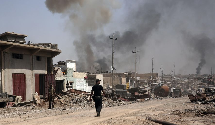 In this Tuesday, May 9, 2017, file photo, smoke rises during heavy fighting between Islamic State militants and Iraqi special forces in the industrial area of west Mosul, Iraq. (AP Photo/Maya Alleruzzo, File)