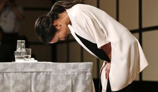 Japanese golfer Ai Miyazato bows at the end of a press conference in Tokyo, Monday, May 29, 2017. Miyazato, a nine-time winner on the U.S. LPGA Tour, announced her retirement at the end of this season. (AP Photo/Shuji Kajiyama)