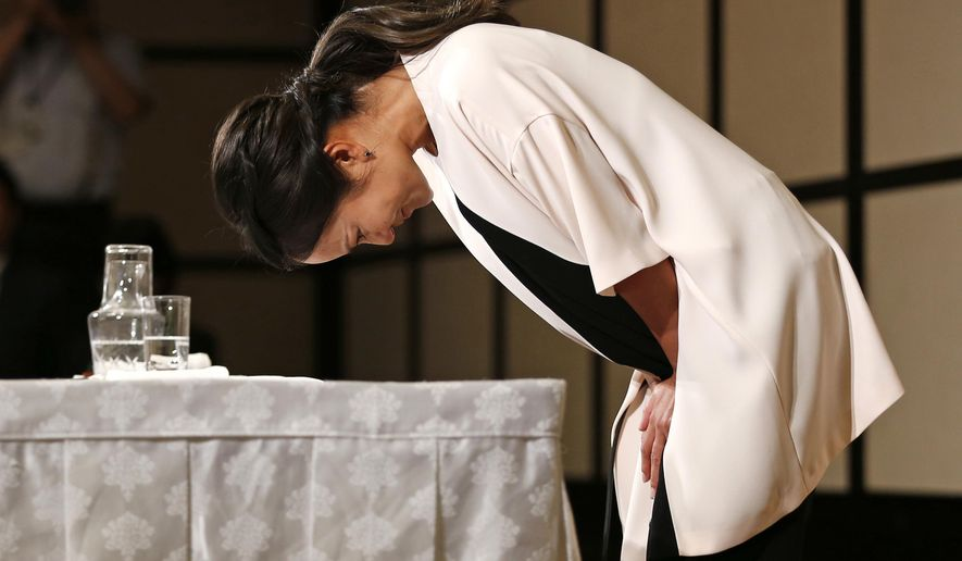 Japanese golfer Ai Miyazato bows at the end of a press conference in Tokyo, Monday, May 29, 2017. Miyazato, a nine-time winner on the U.S. LPGA Tour, announced her retirement at the end of this season. (AP Photo/Shuji Kajiyama)
