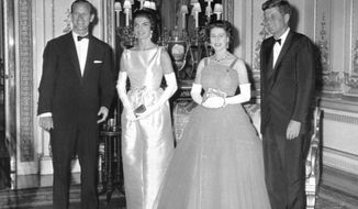 FILE - In this June 5, 1961 file photo, Queen Elizabeth II poses with U.S. President John F. Kennedy, before a state dinner at Buckingham Palace. At left is the Duke of Edinburgh and Kennedy's wife, Jackie, is at second left. Monday, May 29, 2017 marks the 100-year anniversary of John F. Kennedy's birth. (AP Photo/Pool)