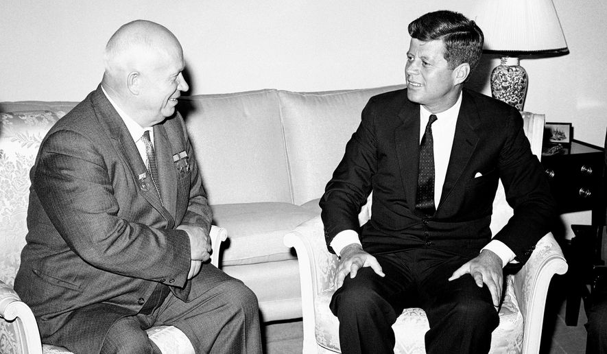 In this June 3, 1961, photo, Soviet Premier Nikita Khrushchev and President John F. Kennedy talk in the residence of the U.S. Ambassador in a suburb of Vienna. The meeting was part of a series of talks during their summit meetings in Vienna. Monday, May 29, 2017 marks the 100-year anniversary of Kennedy's birth. (AP Photo/File)