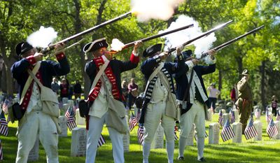 The Sons of the American Revolution, Pikes Peak Chapter fire their guns during a historic reenactment on Memorial Day at the Evergreen Cemetery on Monday 29, 2017 in Colorado Springs, Colo. (Dougal Brownlie/The Gazette via AP)