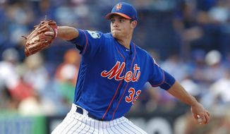 FILE - In this March 11, 2017, file photo, New York Mets starting pitcher Steven Matz works in the first inning of a spring training baseball game against the Washington Nationals in Port St. Lucie, Fla. Matz and Seth Lugo are each scheduled to make one more rehab start in the minors before joining the Mets' rotation. (AP Photo/John Bazemore, File)
