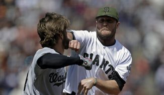 Washington Nationals' Bryce Harper, left, prepares to hit San Francisco Giants' Hunter Strickland after being hit with a pitch in the eighth inning of a baseball game Monday, May 29, 2017, in San Francisco. (AP Photo/Ben Margot) **FILE**