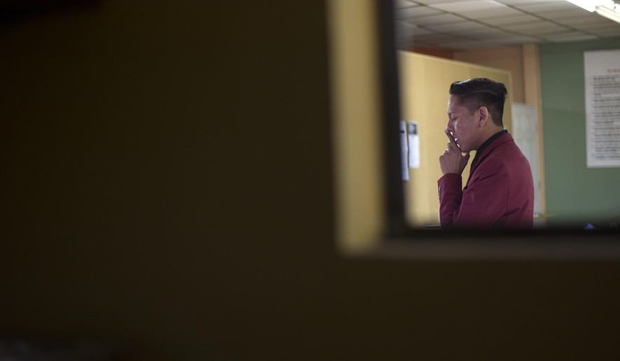 Pernell Manuelito shares his struggles with alcohol and drugs and the path that lead him to sobriety during his speech at an Alcoholics Anonymous meeting in Gallup, N.M. (Cayla Nimmo/Gallup Independent via AP)