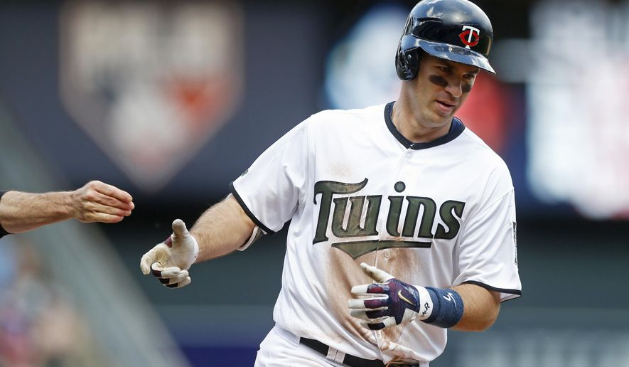 Minnesota Twins' Joe Mauer rounds third base on a solo home run off Tampa Bay Rays pitcher Ryan Garton in the seventh inning of a baseball game Sunday, May 28, 2017 in Minneapolis.  (AP Photo/Jim Mone)