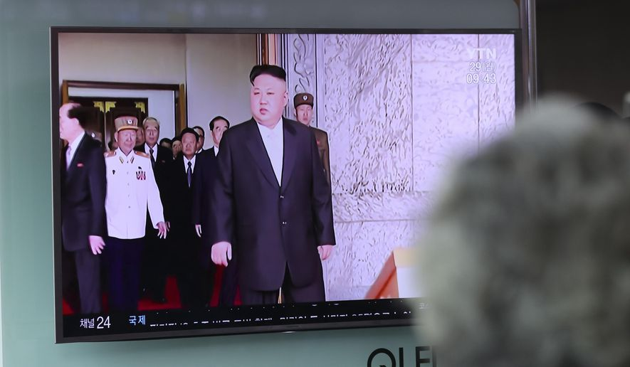 A woman watches a TV screen showing a file footage of North Korean leader Kim Jong-un, at Seoul Train Station in Seoul, South Korea, Monday, May 29, 2017. North Korea fired a short-range ballistic missile that landed in Japan's maritime economic zone Monday, officials said, the latest in a string of test launches as the North seeks to build nuclear-tipped ICBMs that can reach the U.S. mainland. (AP Photo/Lee Jin-man)