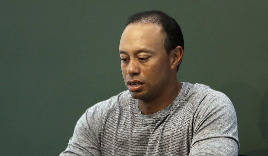 FILE - In this March 20, 2017, file photo, golfer Tiger Woods prepares to sign copies of his new book at a book signing in New York. Police say golf great Tiger Woods has been arrested on a DUI charge in Florida.The Palm Beach County Sheriff's Office says on its website that Woods was booked into a county jail around 7 a.m. on Monday, May 29, 2017. (AP Photo/Seth Wenig, File)