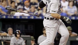 Detroit Tigers' Miguel Cabrera hits a two-run single during the eighth inning of a baseball game against the Kansas City Royals Monday, May 29, 2017, in Kansas City, Mo. (AP Photo/Charlie Riedel)