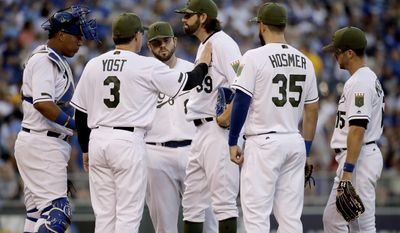 Kansas City Royals manager Ned Yost (3) talks to starting pitcher Jason Hammel (39) before taking him out of a baseball game during the fifth inning against the Detroit Tigers, Monday, May 29, 2017, in Kansas City, Mo. (AP Photo/Charlie Riedel)