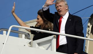 President Donald Trump and first lady Melania Trump wave as they board Air Force One at Naval Air Station Sigonella, Saturday, May, 27, 2017, in Sigonella, Italy. (AP Photo/Evan Vucci)