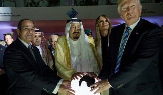 In this Sunday, May 21, 2017 photo released by the Saudi Press Agency, from left to right, Egyptian President Abdel Fattah al-Sissi, Saudi King Salman, U.S. First Lady Melania Trump and President Donald Trump, visit a new Global Center for Combating Extremist Ideology, in Riyadh, Saudi Arabia. (Saudi Press Agency via AP)