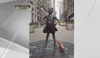 "Artist Alex Gardega placed his statue, called ""Sketchy Pug,"" next to ""Fearless Girl"" for about three hours Monday as a show of support for Arturo Di Modica, the artist who created the iconic Wall Street bull. (Image: Screen grab of Alex Gardega's work via NBC 4 New York)"