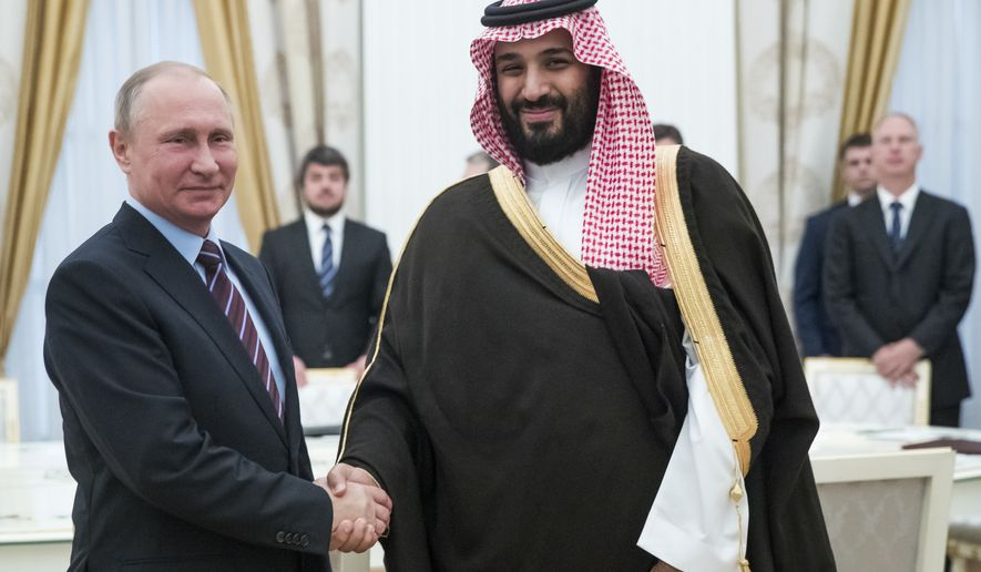 Russian President Vladimir Putin, left, shakes hands with Saudi Deputy Crown Prince and Defense Minister Mohammed bin Salman in Moscow's Kremlin, Russia, Tuesday, May 30, 2017. (AP Photo/Pavel Golovkin, pool)