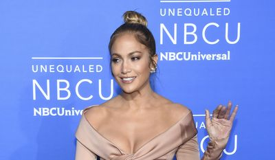 """FILE - In this May 15, 2017 file photo, Jennifer Lopez attends the NBCUniversal Network 2017 Upfront in New York. NBC is saying bye-bye this year to its tradition of an annual live holiday musical. The network is confirming that """"Bye Bye Birdie"""" starring Lopez has been pushed from its announced December airdate into 2018 on an as-yet-undetermined night. (Photo by Evan Agostini/Invision/AP, File)"""