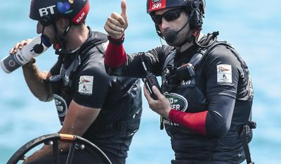 In this photo provided by the America's Cup Event Authority, a member of Great Britain's Land Rover BAR crew gestures during America's Cup qualifying against Sweden's Artemis Racing on the Great Sound in Bermuda on Tuesday, May 30, 2017.  (Gilles Martin-Raget/ACEA via AP)
