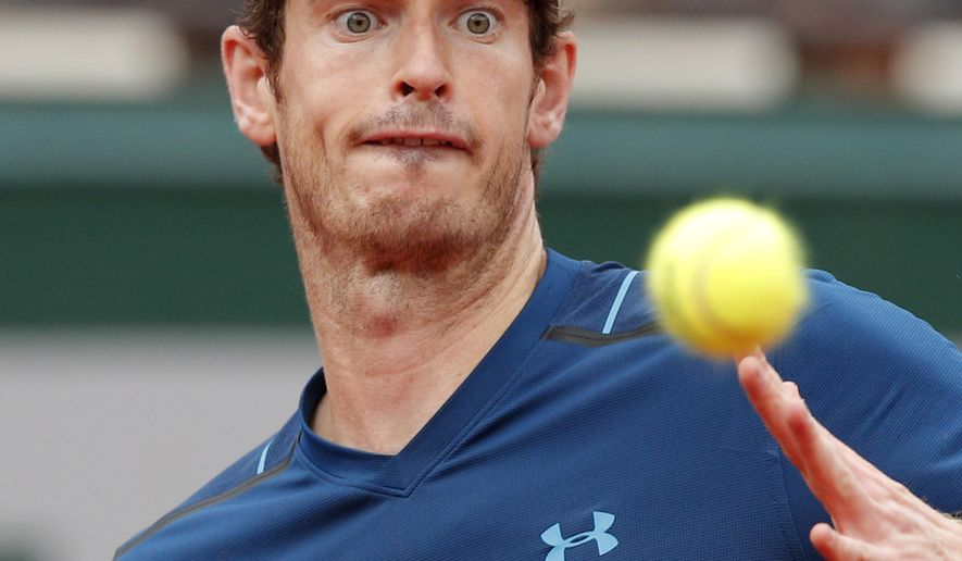 Britain's Andy Murray eyes the ball as he plays Russia's Andrey Kuznetsov during their first round match the French Open tennis tournament at the Roland Garros stadium, Tuesday, May 30, 2017 in Paris. (AP Photo/Christophe Ena)