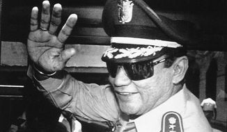 FILE - In this Aug. 31, 1989 file photo, Gen. Manuel Antonio Noriega waves to the press after a state council meeting at the presidential palace in Panama City, where the new president was announced. Panama's ex-dictator Noriega died Monday, May 29, 2017 in a hospital in Panama City. He was 83. (AP Photo/Matias Recart, File)