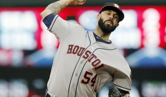 Houston Astros pitcher Mike Fiers throws against the Minnesota Twins in the first inning of a baseball game Tuesday, May 30, 2017 in Minneapolis. (AP Photo/Jim Mone)