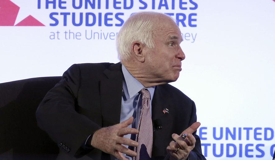 U.S. Sen. John McCain has a discussion after delivering a speech at the invitation of the United States Studies Centre in Sydney, Tuesday, May 30, 2017. In February, the Republican senator leaped to Australia's defense after President Donald Trump got into a heated discussion with Australian Prime Minister Malcolm Turnbull over an Obama-era agreement on the resettlement of refugees. (AP Photo/Rick Rycroft)