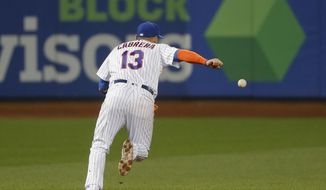 New York Mets shortstop Asdrubal Cabrera (13) chases after the ball after dropping a pop fly hit by Milwaukee Brewers' Jett Bandy that allowed two runs to score during the seventh inning of a baseball game, Tuesday, May 30, 2017, in New York. (AP Photo/Julie Jacobson)