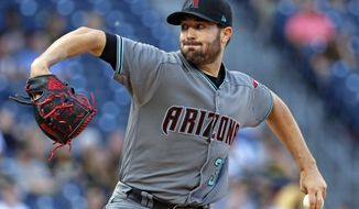 Arizona Diamondbacks starting pitcher Robbie Ray delivers in the first inning of a baseball game against the Pittsburgh Pirates in Pittsburgh, Tuesday, May 30, 2017. (AP Photo/Gene J. Puskar)