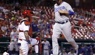 Los Angeles Dodgers' Adrian Gonzalez, right, scores past St. Louis Cardinals catcher Yadier Molina during the ninth inning of a baseball game Tuesday, May 30, 2017, in St. Louis. (AP Photo/Jeff Roberson)