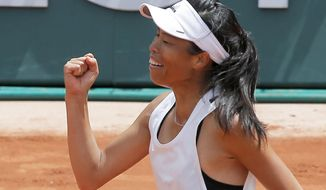 Taiwan's Su-Wei Hsieh celebrates winning her first round match against Britain's Johanna Konta in three sets, 1-6, 7-6 (7-2), 6-4, at the French Open tennis tournament at the Roland Garros stadium, in Paris, France. Tuesday, May 30, 2017. (AP Photo/Michel Euler)