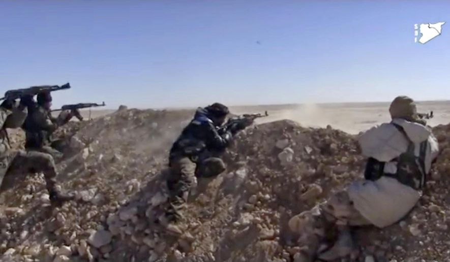 In this Monday, March 6, 2017, file photo, this frame grab from a video provided by the Syria Democratic Forces (SDF), shows fighters from the SDF opening fire on an Islamic State group's position, in Raqqa's eastern countryside, Syria. (Syria Democratic Forces, via AP, File)