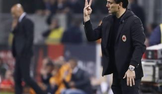 FILE - In this Sunday, May 7, 2017 file photo, AC Milan coach Vincenzo Montella gives indications during a Serie A soccer match between AC Milan and Roma, at the San Siro stadium in Milan, Italy, Sunday, May 7, 2017.  Vncenzo Montella has extended his contract as AC Milan manager by one year through the 2018-19 season. The announcement was made live on Facebook with Montella, Milan CEO Marco Fassone and sporting director Massimiliano Mirabelli. The move comes two days after Montella guided Milan to a sixth-place finish in Serie A and a spot in the Europa League playoffs in his first season in charge. (AP Photo/Luca Bruno, File)