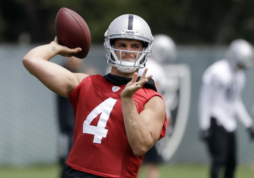 Oakland Raiders quarterback Derek Carr throws during the team's organized team activity at its NFL football training facility Tuesday, May 30, 2017, in Alameda, Calif. (AP Photo/Marcio Jose Sanchez)