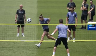 Real Madrid's Gareth Bale heads a ball during a training session at a media open day in Madrid, Tuesday May 30, 2017. Real Madrid will play Juventus Saturday in the Champions League final in Cardiff. (AP Photo/Paul White)